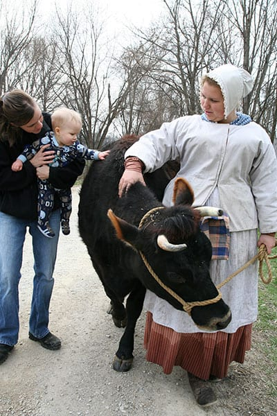 Prairietown resident with cow
