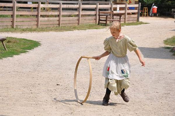 girl spinning hoop