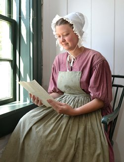 Mrs Gregory Reading A Ltr From Mr Gregory Crop