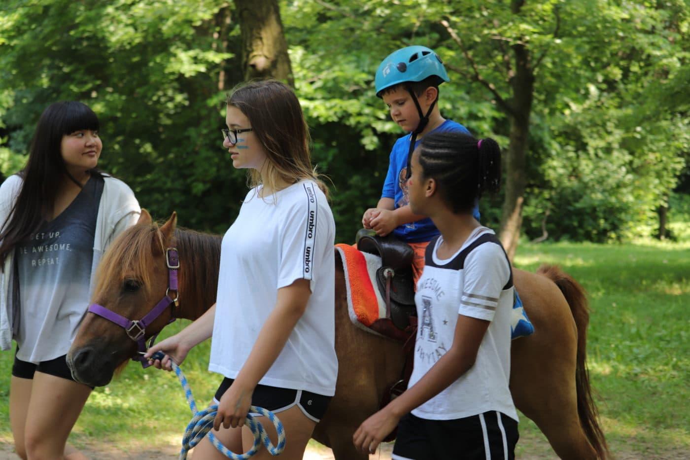 Horseback riding at summer camp