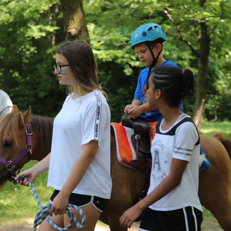 Horseback riding at summer camp