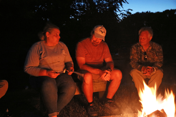 Group sitting around the campfire
