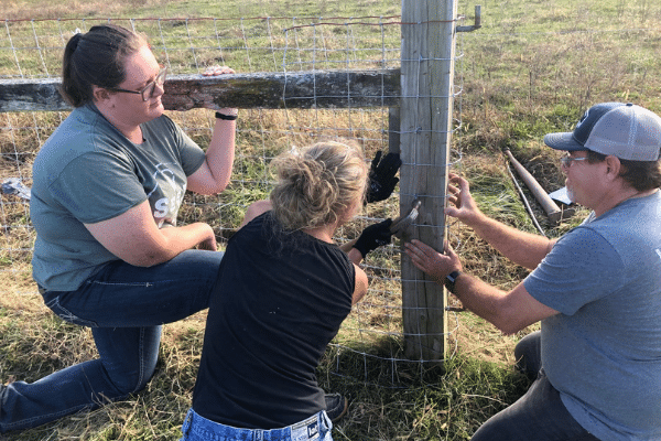 Ag staff working on fence