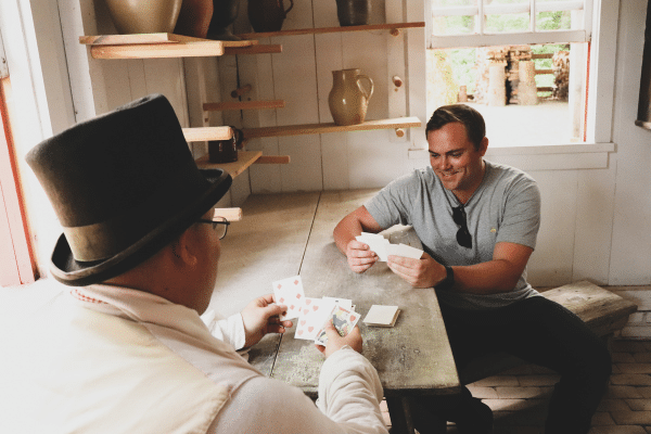 History on Tap guest playing cards with a Conner Prairie interpreter