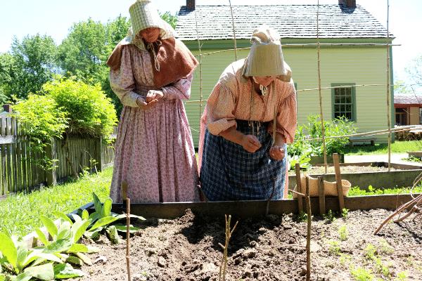 Conner Prairie interpreters in the garden