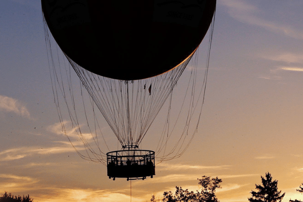 Silhouette of 1859 Balloon Voyage at Sunset