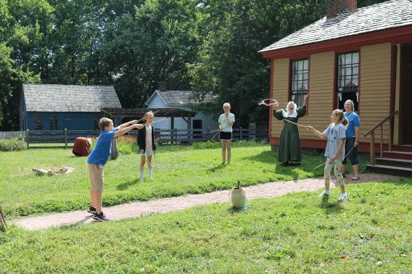Guests playing summer games in Prairietown