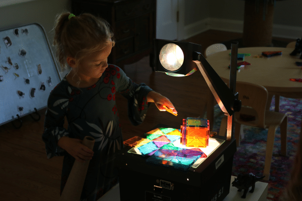 Student Using Colored Shapes on Projector