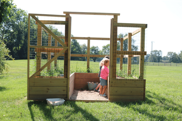 Two children learning outdoors at Preschool on the Prairie Garden