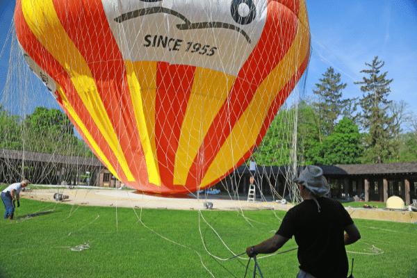 Volunteers helping with hot air balloon deflation