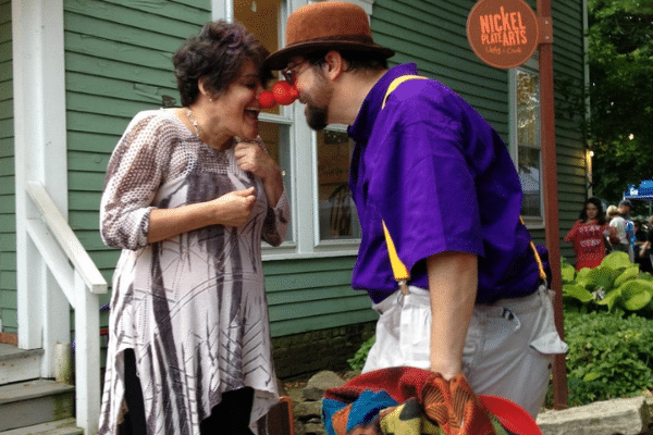 Clown and audience member interacting