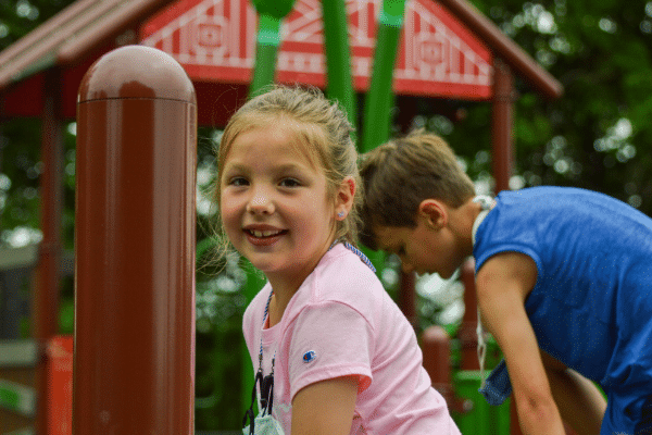 Girl playing at Ag Adventures playground
