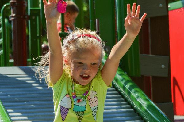 Girl playing on Ag Adventures slide