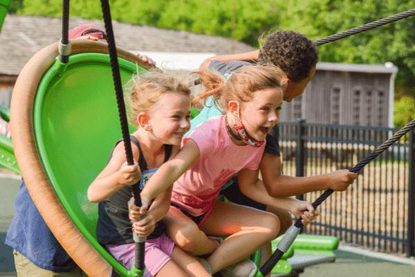Children Having Fun On The Swing At Ag Adventures