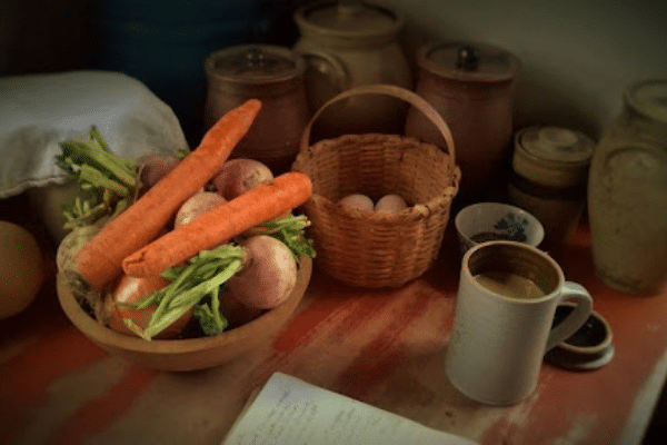 Veggies and eggs in baskets on table