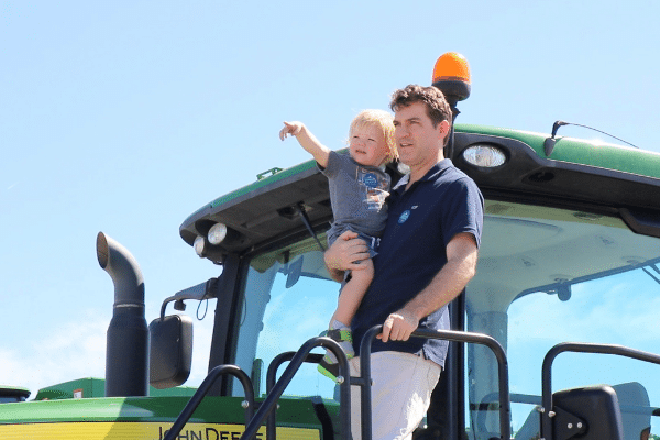 Father And Toddler Son On Tractor