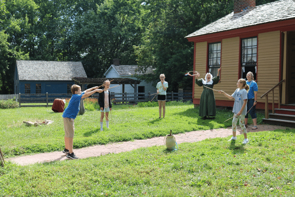 Guests Playing A Game With Prairietown Interpreter