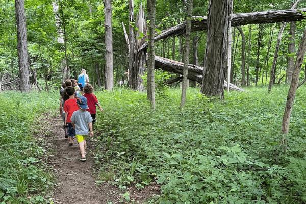 Preschool on the Prairie class exploring the Conner Prairie grounds