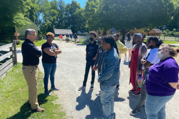 President and CEO Norman Burns and Curatorial Director Dr. Charlene Fletcher welcome Academy members and Teaching Artist AshLee Baskin to Prairie Town