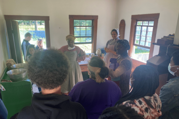 The cast interacting with Historic Interpreters while visiting the Eagle Inn.