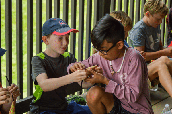 Two Boys Working Together On A Craft Project