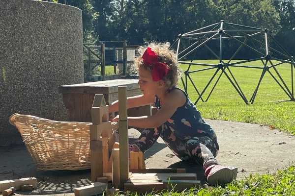 Little Girl Building With Wooden Blocks