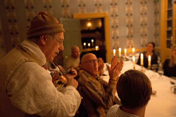 Hearthside Supper Guests Enjoying Live Music