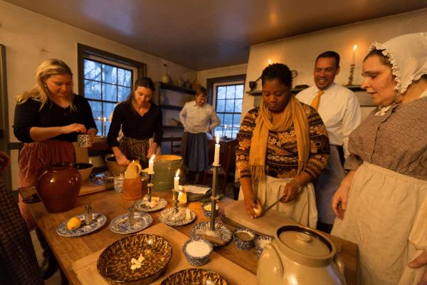 Hearthside Supper Guests Preparing Meal